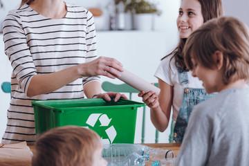 Mother teaching kids segregating waste