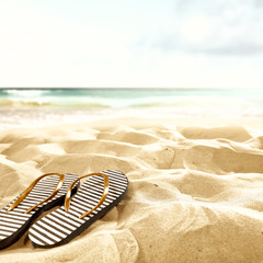 flip flops on beach and summer time