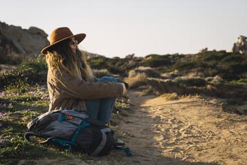 Italy, Sardinia, woman on a hiking trip having a break