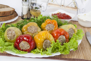 Bulgarian pepper stuffed with meat with herbs sauce and sour cream. A fine meal for lunch.