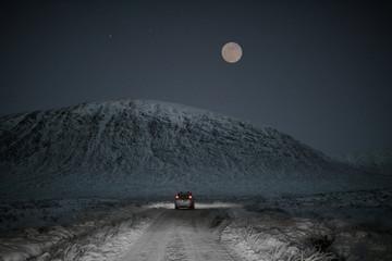 Full moon in a snowy road