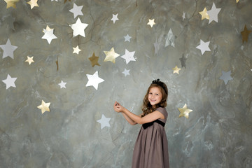 portrait of a happy girl on a background of stars