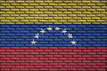 Venezuela flag is painted onto an old brick wall