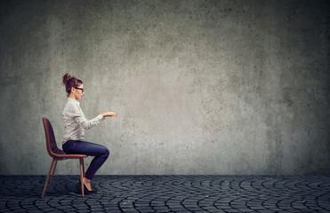 Woman sitting at imaginary table