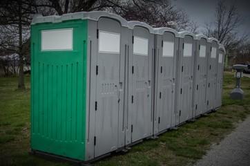 Row of plastic portable bathrooms