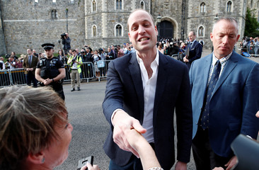 Britain's Prince William greets wellwishers outside Windsor Castle ahead of Prince Harry's wedding to Meghan Markle tomorrow, in Windsor