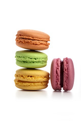 Pyramid of three macaroons and pink one nearby