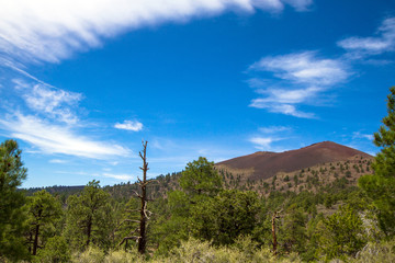 Sunset Crater is an extinct volcano whose lava field is protected as Sunset Crater National Monument near Flagstaff, Arizona