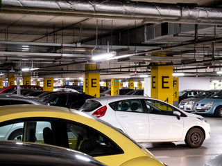 Underground garage in a shopping mall with a lot of cars