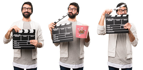 Set of Hipster man holding a clapperboard