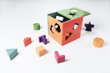 3D Rendering of a wooden sorting cube baby toy