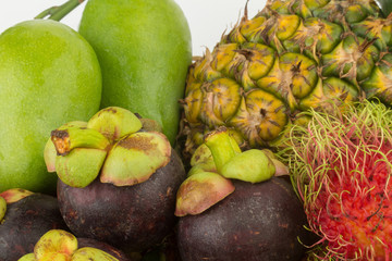 rambutan. pineapple. manggo green. mangosteen. closeup