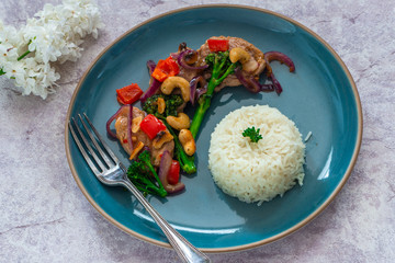 Sichuan pork, broccoli, red pepper and cashew stir-fry with rice - top view