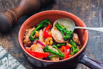 Sichuan pork, broccoli, red pepper and cashew stir-fry
