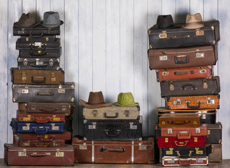 old suitcases, hats and boots