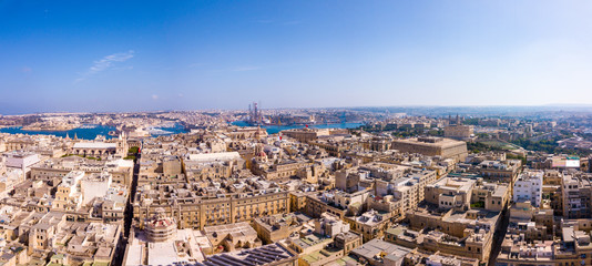 Amazing aerial view of the Valletta old town on Malta. View on ancient buildings, cathedrals and narrow streets.