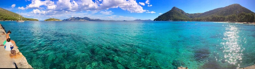 Panorama of a crystal clear blue ocean at Playa de Formentor, Mallorca, Spain