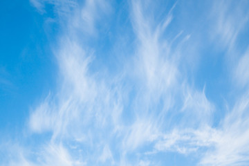 Blue sky with white abstract clouds background