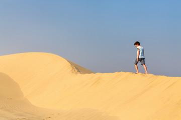 Teenage boy having fun at desert