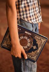 Man holding the Quran