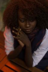Woman, black, dark, dark skin, portrait, natural hair, sitting, indoor, African