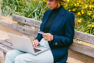 Woman with a hat doing online shopping