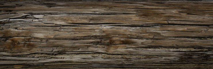 Old Dark rough wood floor or surface with splinters and knots. Square background with flooring or boards with wood grain. Old aged timber in a barn or old house. Wall mural