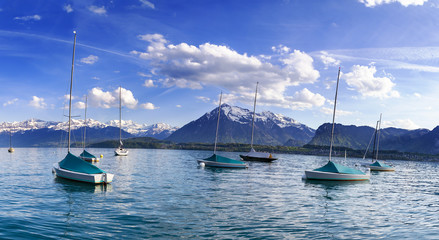 Sailing boats in port at lake Thun infornt of Alps mountain in the evening