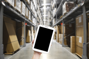 hand of people holding tablet or smartphone for check product stock or internet online shopping in warehouse or department store on blank and black screen display