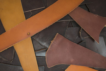 Cutting leather of different colors and decorations as a background for design