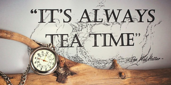 It´s always time for tea - silver pocket watch with chain on a tree branch quoting the Mad Hatter from Alice in Wonderland