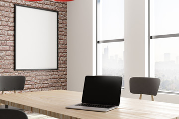 Modern conference room with poster and laptop