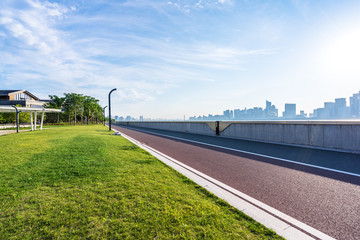 city skyline with road