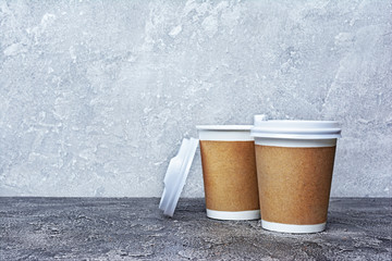 Take-out blank paper brown coffee cups with white covers and craft cup holders