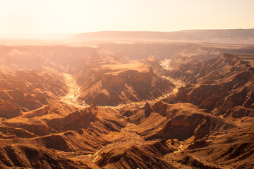 Horseshoe bend in Fish River Canyon on hot sunny day, Namibia.