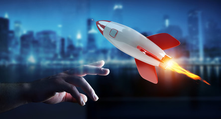 Businessman holding and touching a rocket 3D rendering