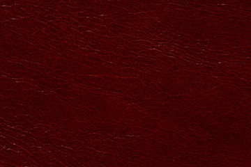 Perfective dark red leather background.