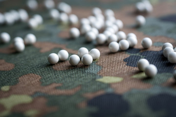 airsoft balls on the background of camouflage fabric