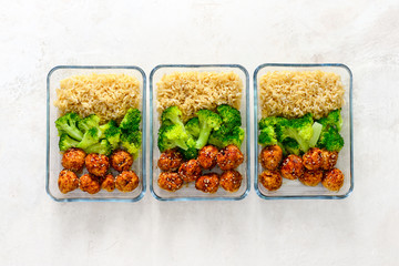 Asian style chicken meat balls with broccoli and rice in a take away lunch boxes