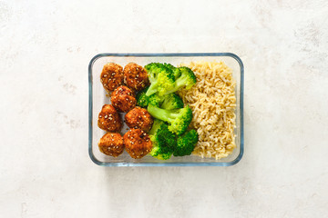 Asian style chicken meat balls with broccoli and rice in a take away lunch box