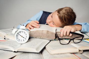 Child Sleep on Books, Tired Student Kid Studying, Face Lying on Book near Alarm Clock, Children Hard Education Concept