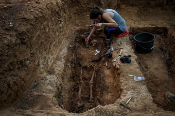 A member of the Association for the Recovery of Historical Memory (ARMH) takes part in the exhumation of Vicente Espliego Andres who was shot in 1939 by forces of dictator Francisco Franco in Guadalajara's cemetery