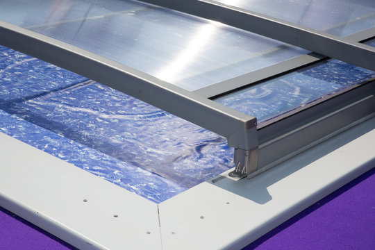Outdoor swimming pool with a shelter detail