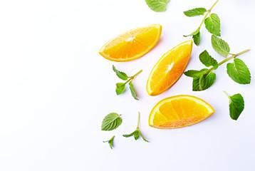 Fresh Orange and Mint Leaves on White Background