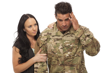 Wife comforting her military husband