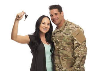 Young military couple with car key