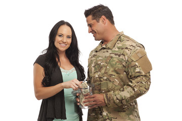 Military Couple collecting money in glass jar