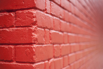 Crop shot of a red weathered wall that has an infinite endless blur view