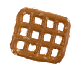Top view of a single waffle pretzel on a white background.