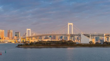 Wall Mural - Time lapse of Rainbow bridge with sunlight in morning, Tokyo in Japan.